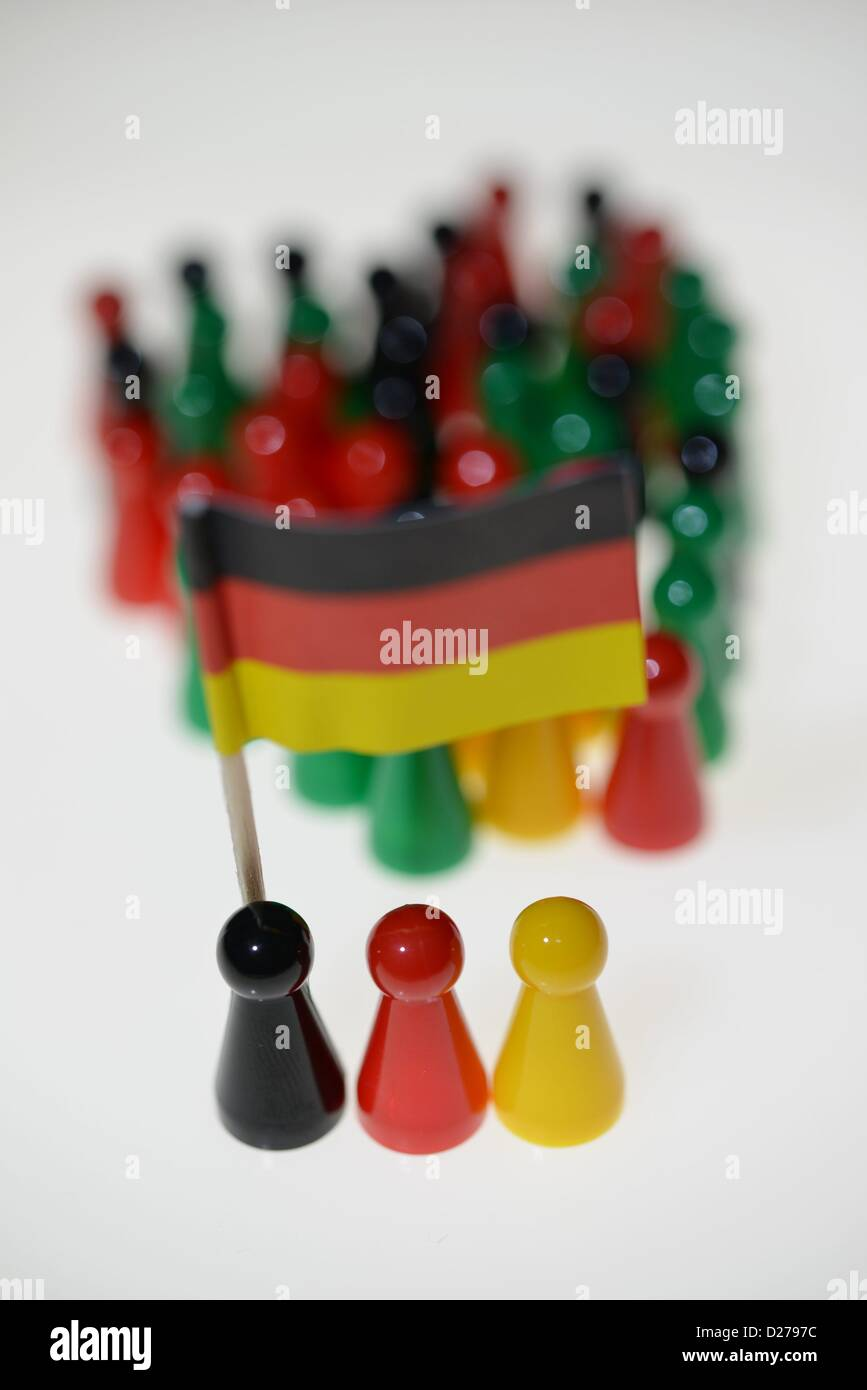Pawns of a game standing on a table. Photo: Frank May Stock Photo