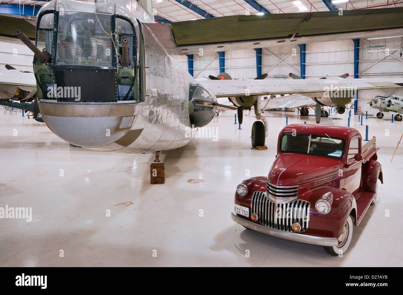 Tail, turret of Consolidated PB4Y-2 Privateer Navy Bomber and 1941 Chevrolet truck, Lone Star Flight Museum, Galveston, - Stock Image