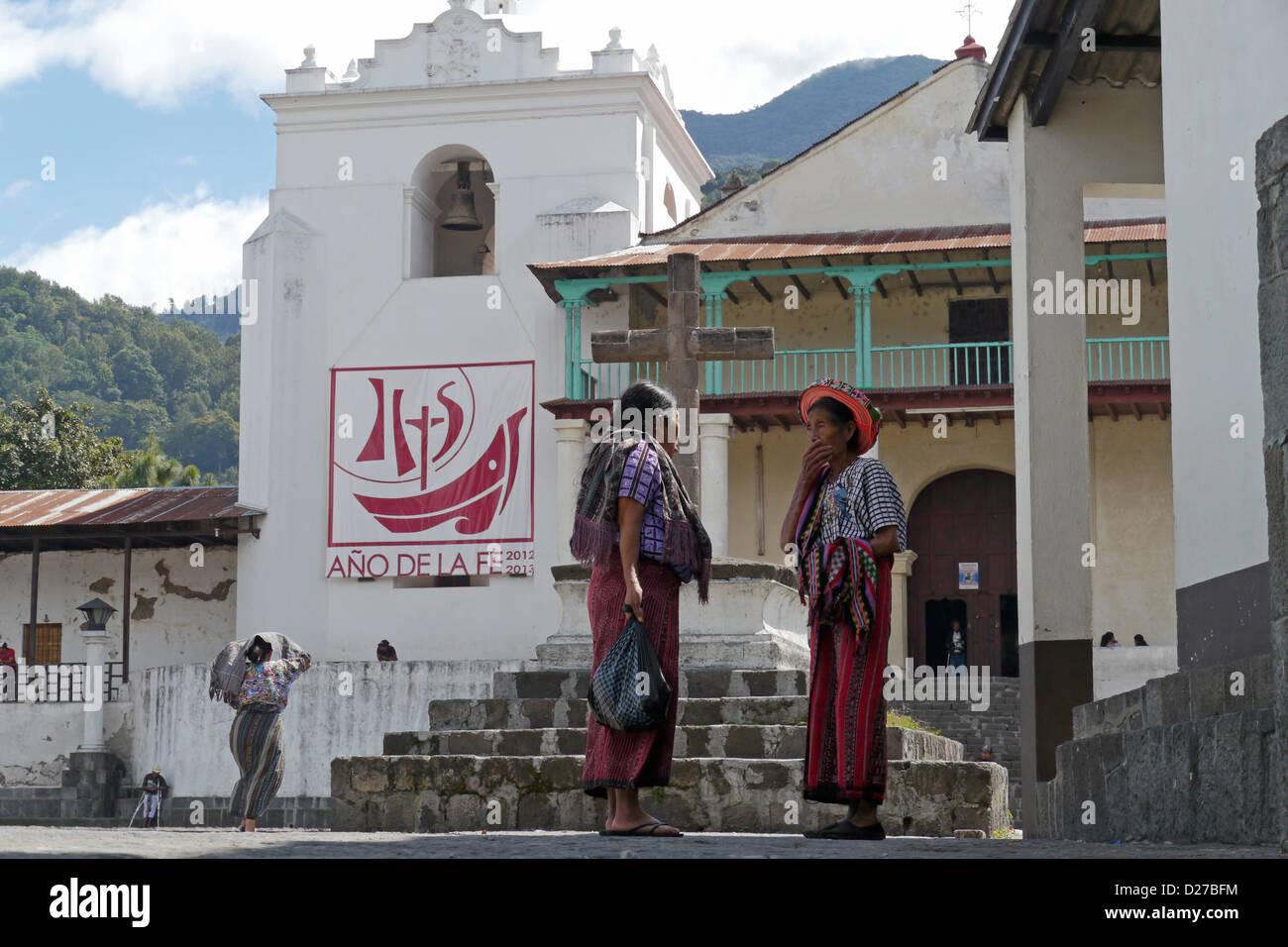 The catholic church, Santiago de Atitlan. Woman in traditional dress. - Stock Image