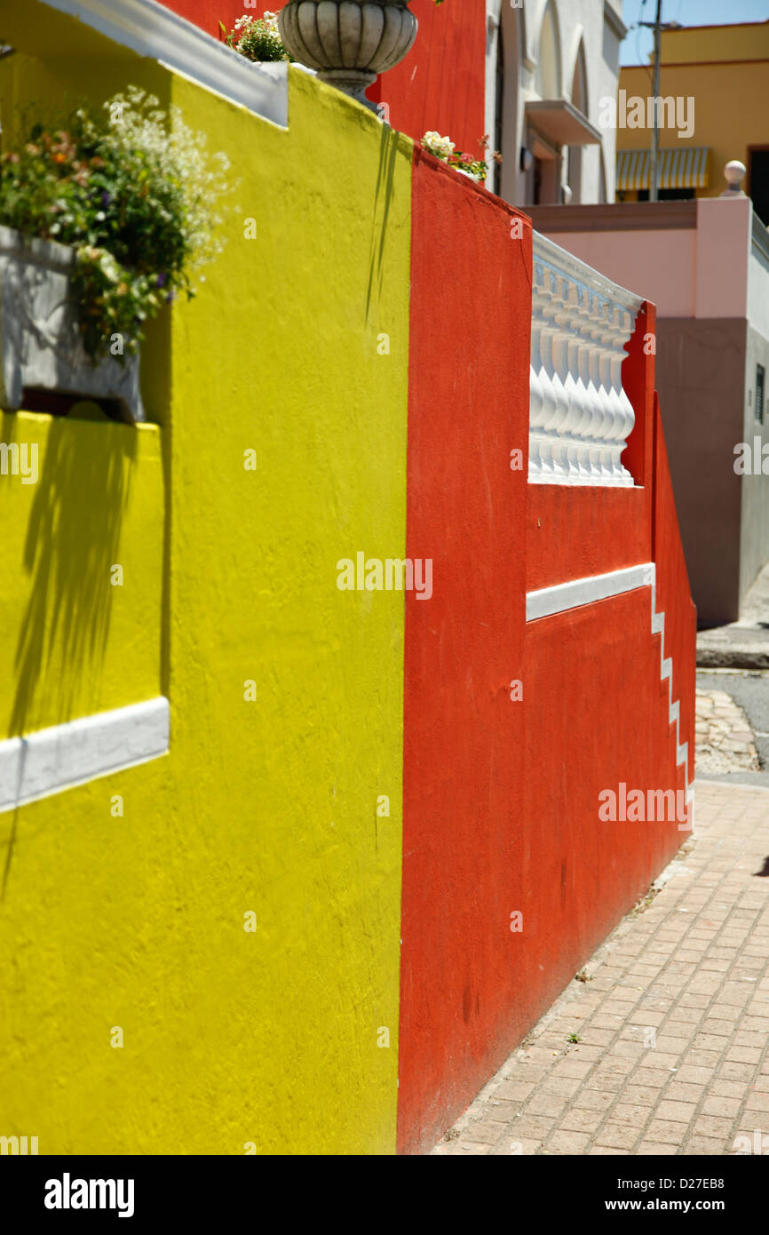 Acute view of a yellow and orange walls in a street scene - Stock Image