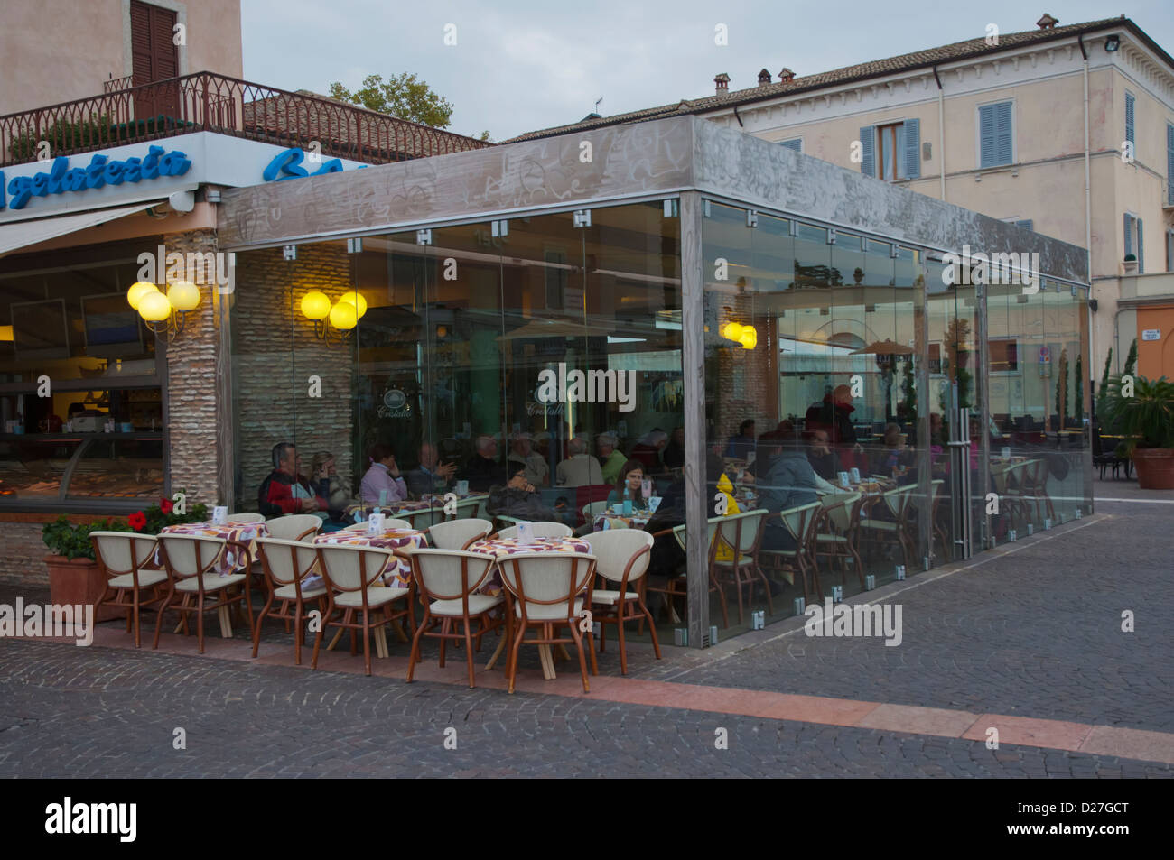 Cafe with glass walls and ceiling at waterfront Bardelino town Lago di Garda the Garda Lake the Veneto region Italy - Stock Image