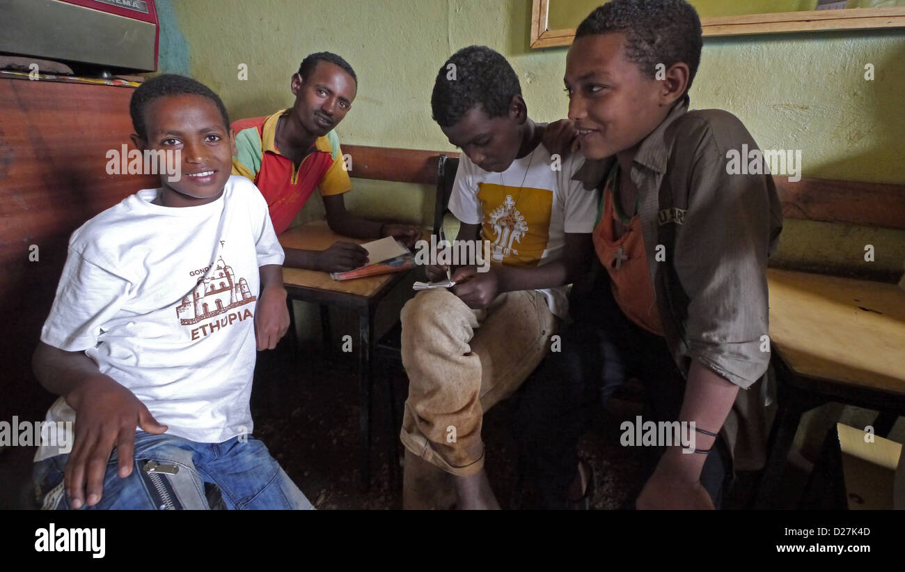 ETHIOPIA The 'Salam Cafe' in Chagni, Beni Shangul Gumuz region. Boys having breakfast. Stock Photo