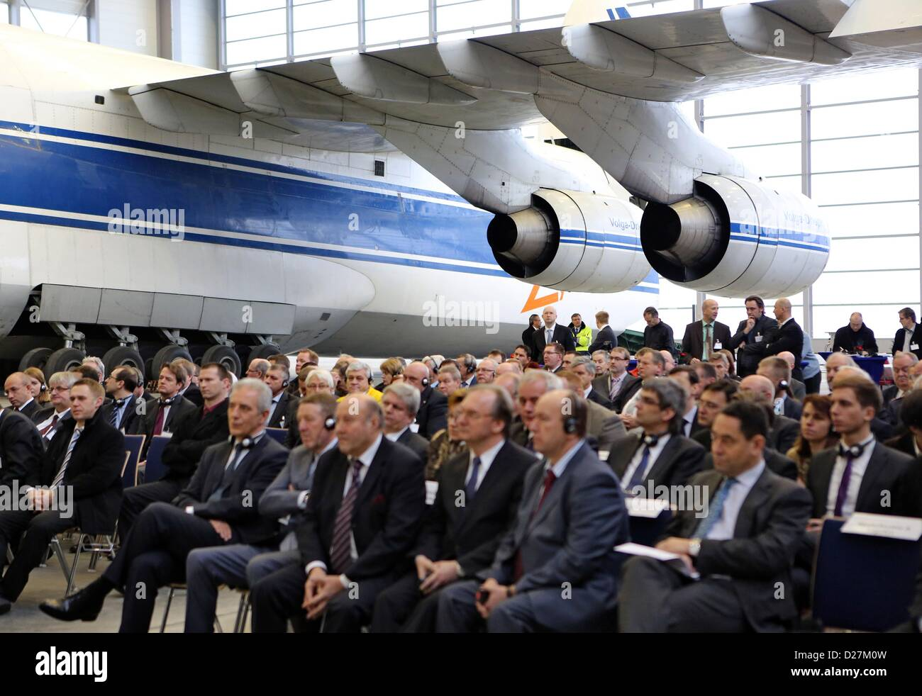 Leipzig/Halle in Schkeuditz, Germany, 16th January 2013. People sit in front of a Antonov 124 during the opening Stock Photo