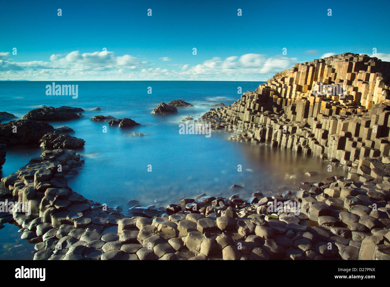 Beautiful day in the afternoon sun on the famous Giant's Causeway on the Antrim Coast of Northern Ireland - Stock Image