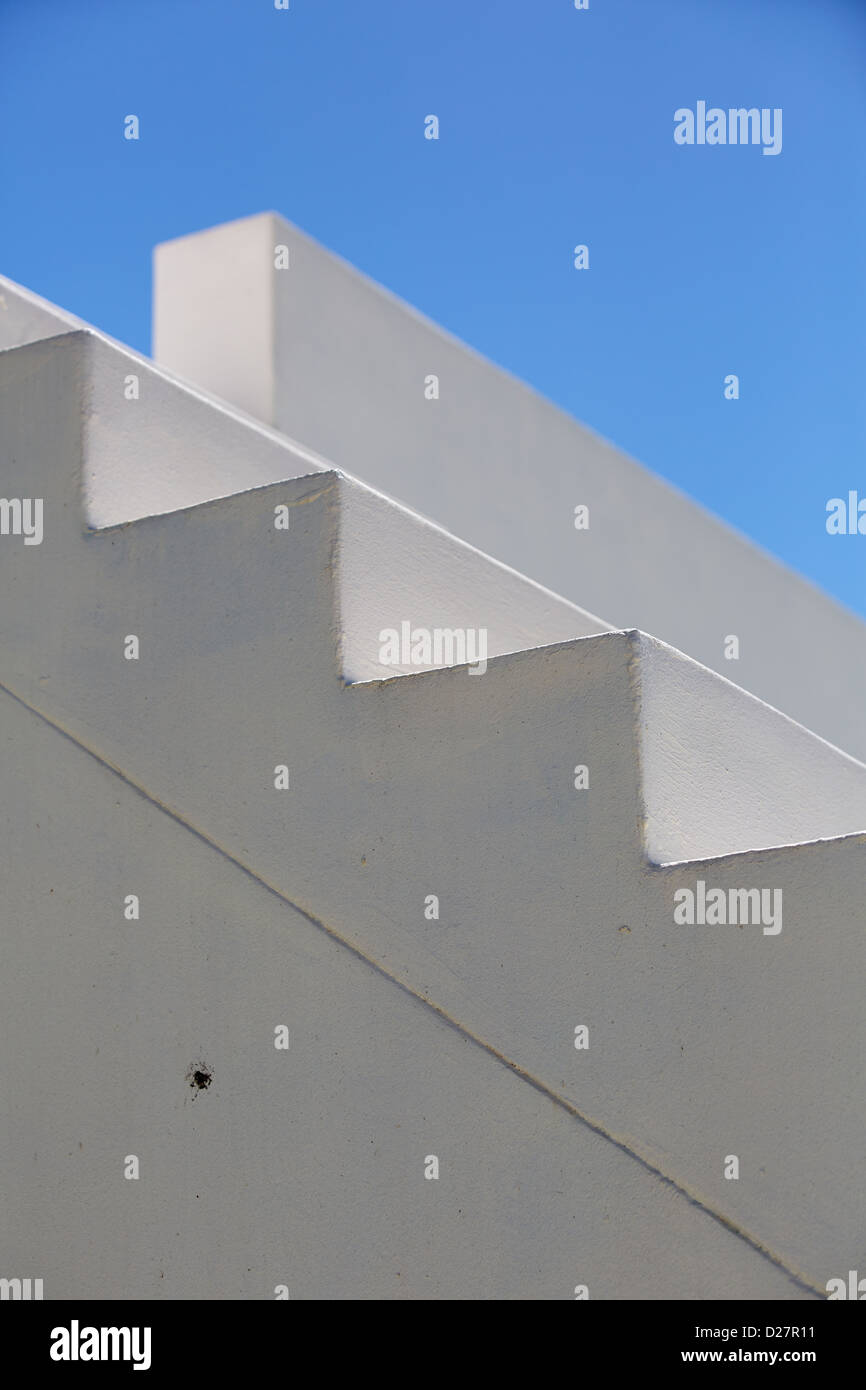 Close up detail of white stone staircase against a blue sky - Stock Image