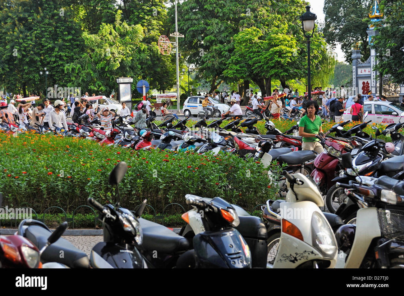 Vietnam - Rows of parked scooters and mopeds lining streets in Hanoi city centre Stock Photo