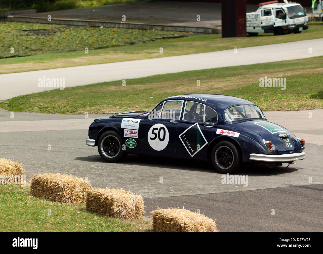Derek Pearce driving a 1961 Jaguar MkII, in the Sprint event at motorsport at the palace 2011 - Stock Image