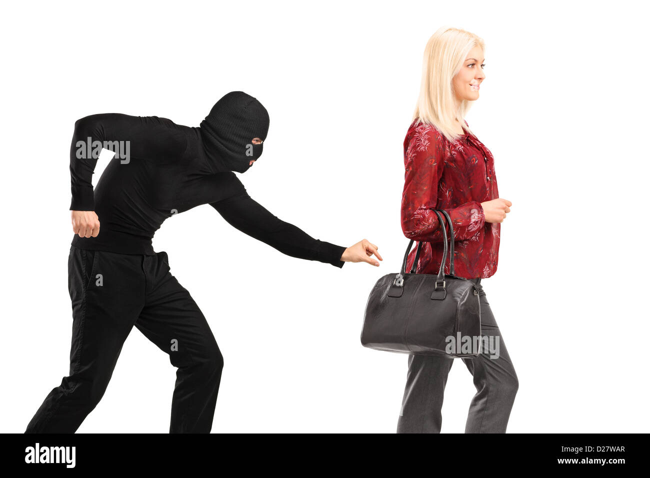 A pickpocket with mask trying to steal a from a woman carrying a purse isolated on white background Stock Photo