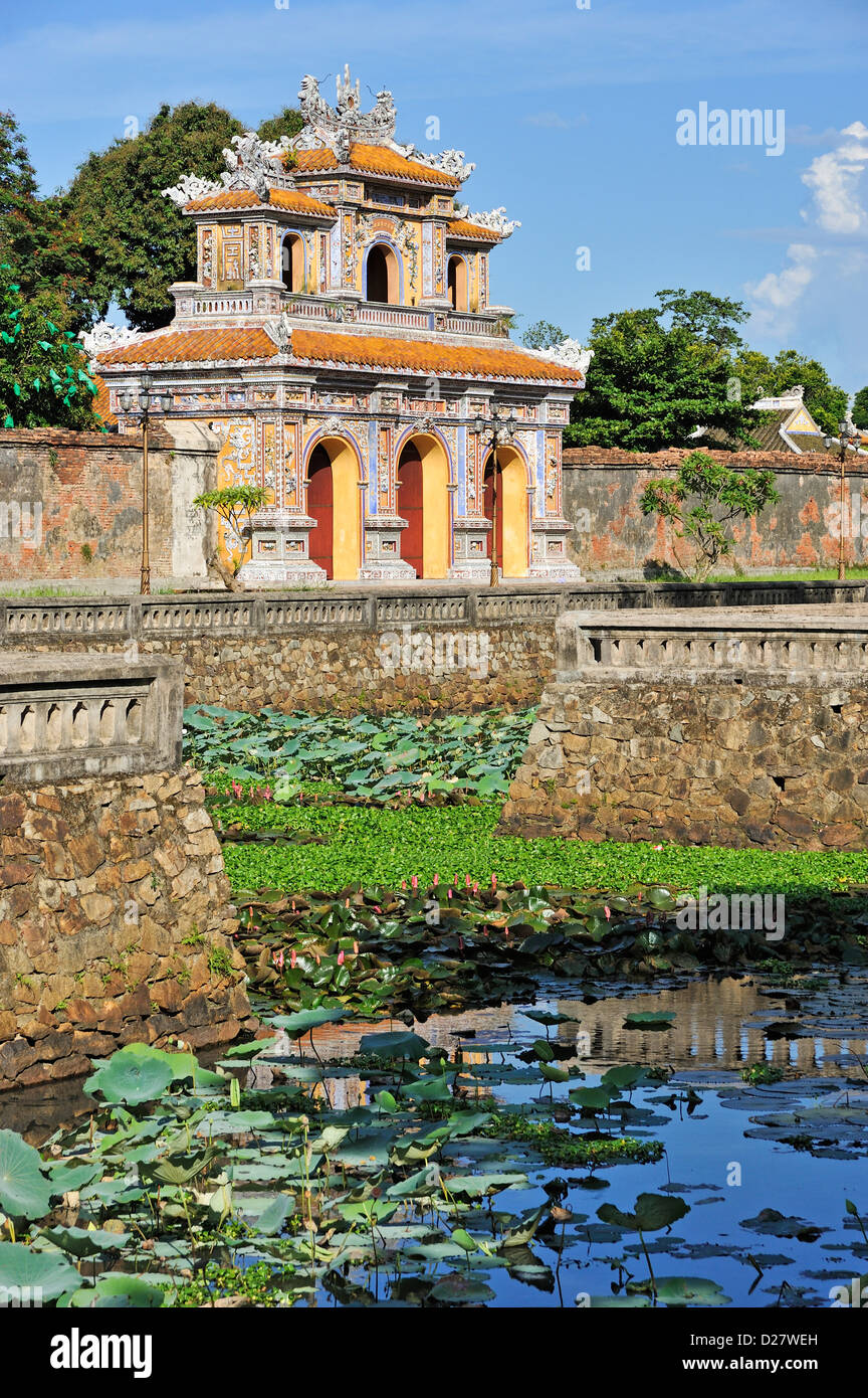 One of the gates of the Imperial City / Citadel of Hue, Vietnam - looking from inside the city across the ornate - Stock Image