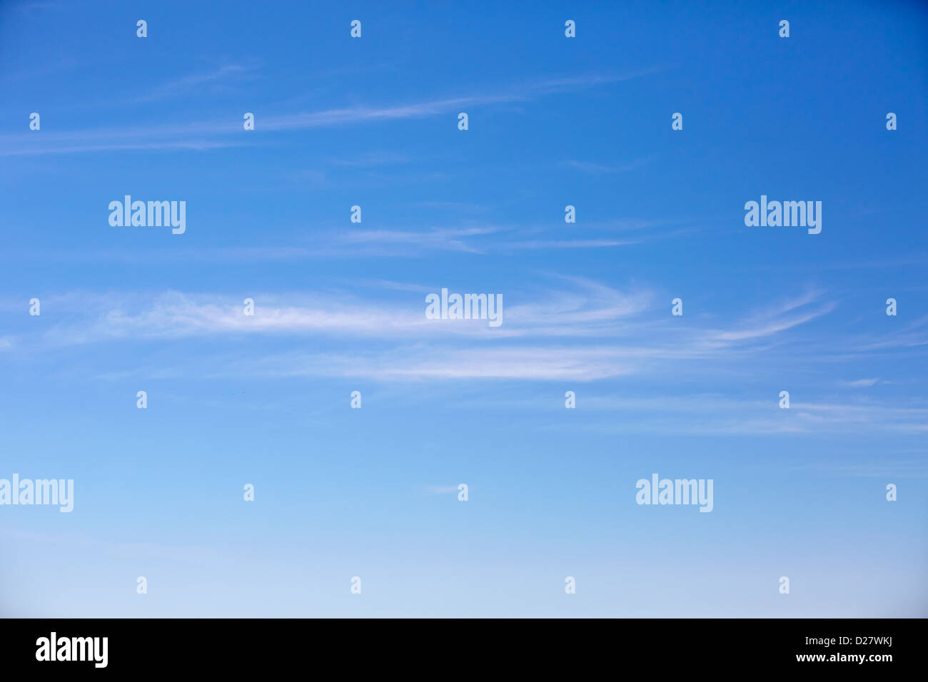 Wispy clouds in the sky - Stock Image