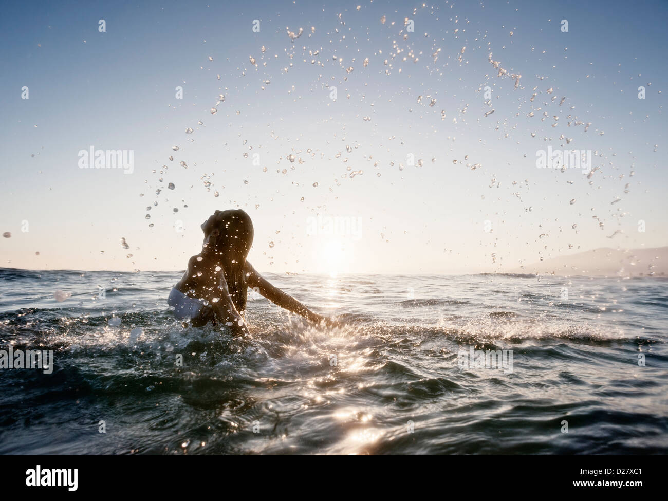 Woman in the sea. - Stock Image