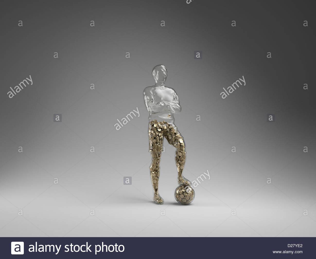 Coins filling half of hollow soccer player Stock Photo