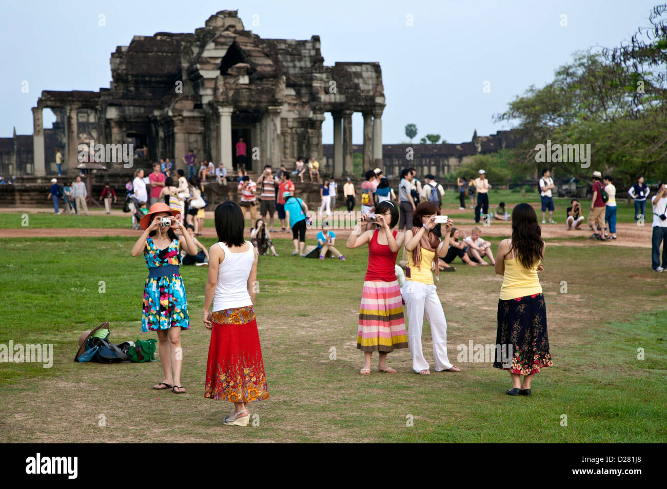 Japanese tourists taking snapshots. Angkor Wat. Cambodia Stock Photo