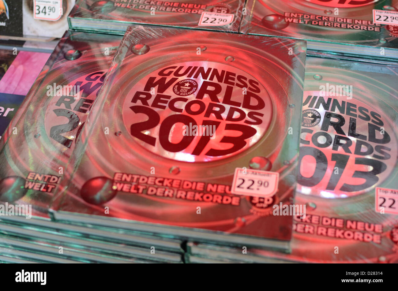Copies of Guinness World Records (Swiss edition) on a stall - Stock Image