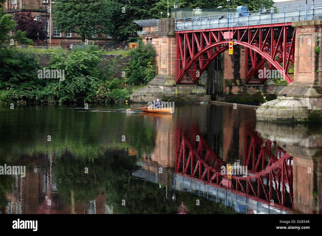 Officer George Parsonage from Glasgow Humane Society inspecting the River Clyde at the Tidal Weir and Pipe Bridge, - Stock Image