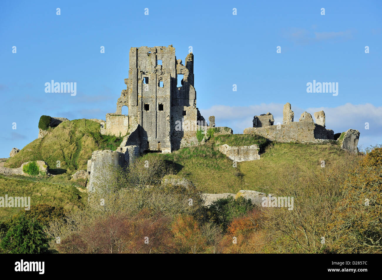 Ruins of the medieval Corfe Castle on the Isle of Purbeck along the Jurassic Coast in Dorset, southern England, - Stock Image