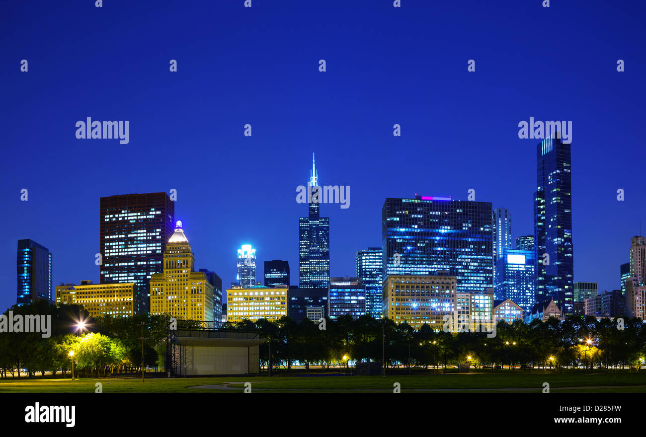 lights of the downtown chicago il in the evening stock photo