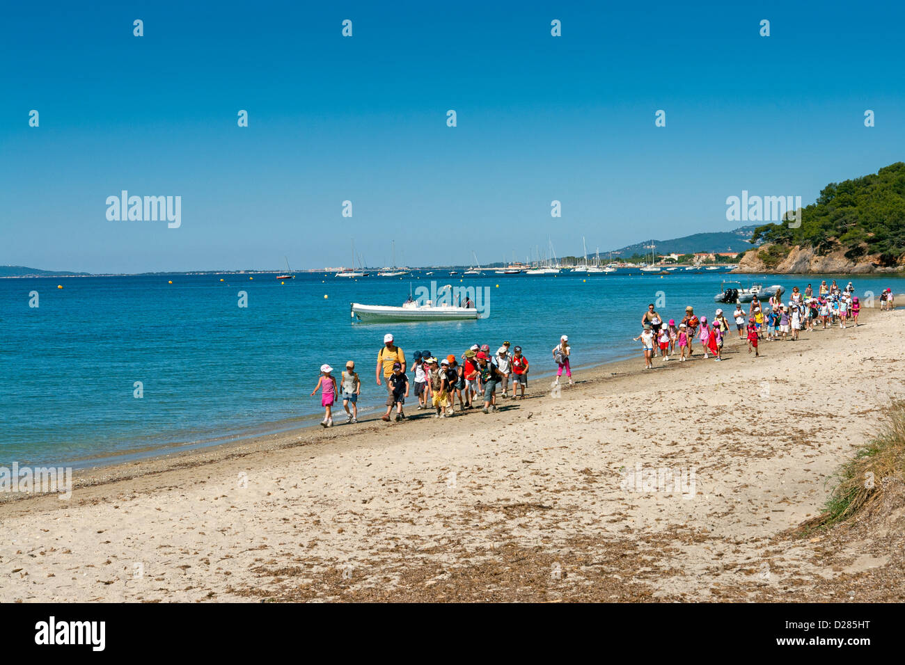 School outing on Plage du Pellegrin, a secluded beach near Bormes-les-Mimosas, Var, Provence, France - Stock Image