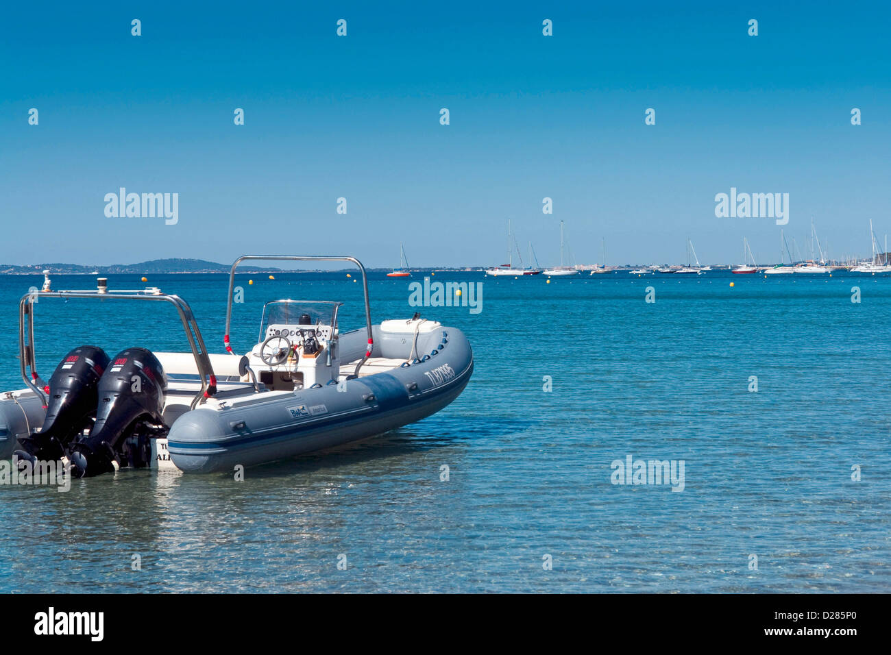 Inflatable boat with twin outboard motors moored in the Mediterrean - Stock Image