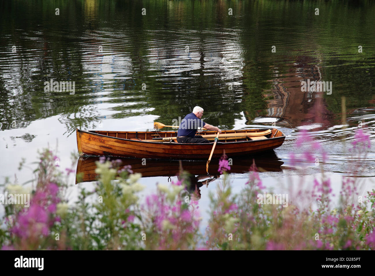 Officer George Parsonage of the charity the Glasgow Humane Society rowing on the River Clyde in Glasgow, Scotland, - Stock Image