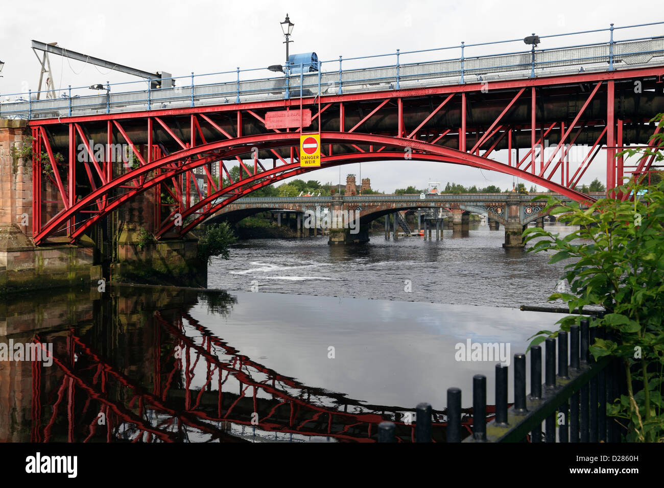 View West along the River Clyde to the Pipe Bridge and Tidal Weir, Glasgow, Scotland, UK - Stock Image