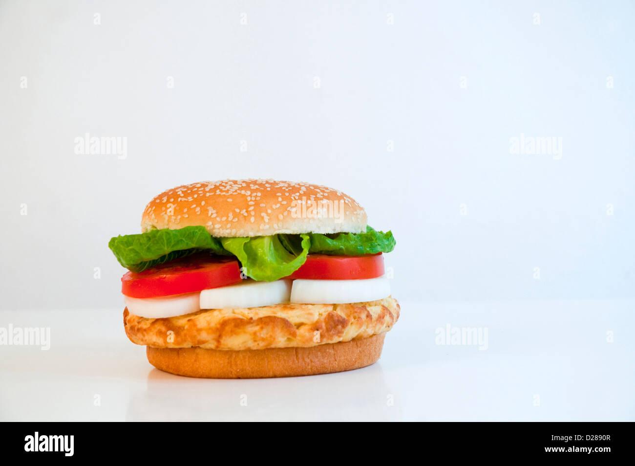 Spanish omelet as a hamburger. - Stock Image