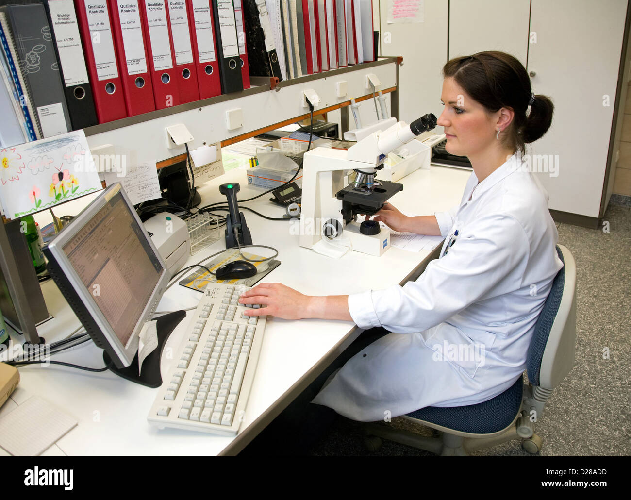 Essen, Germany, Zytologieassistentin examines blood cells under the microscope Stock Photo