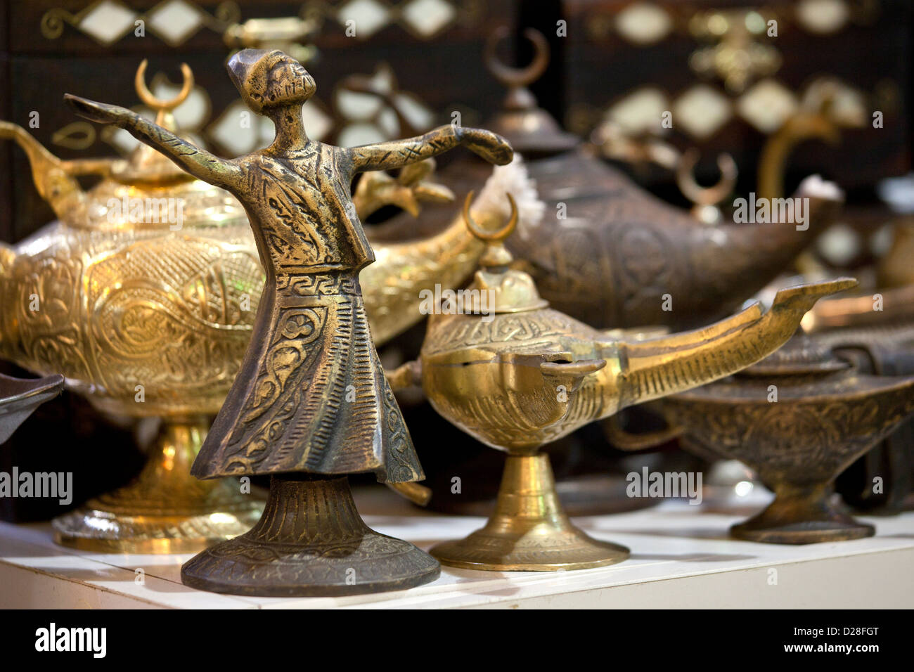 Turkish whirling dancing dervish model souvenir and magic Aladin oil lamp lamps for sale in Grand Bazaar Market Stock Photo