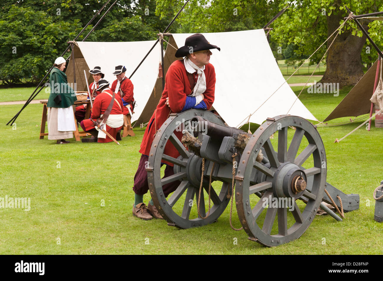 17th century soldier leaning on a cannon - Stock Image