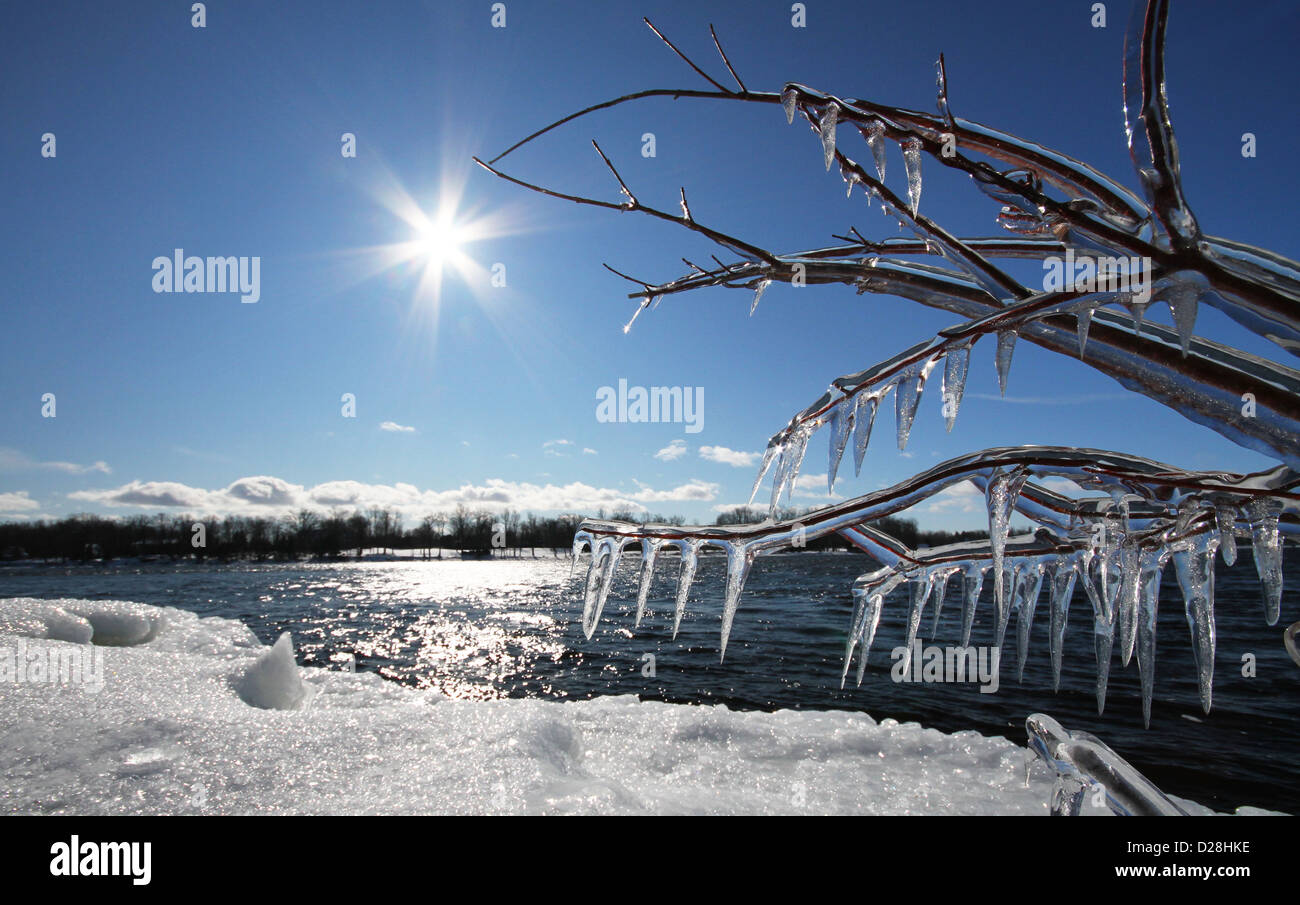 Winter tale. Canadian winter landscape with ice, sun and snow over the St. Laurence River. - Stock Image