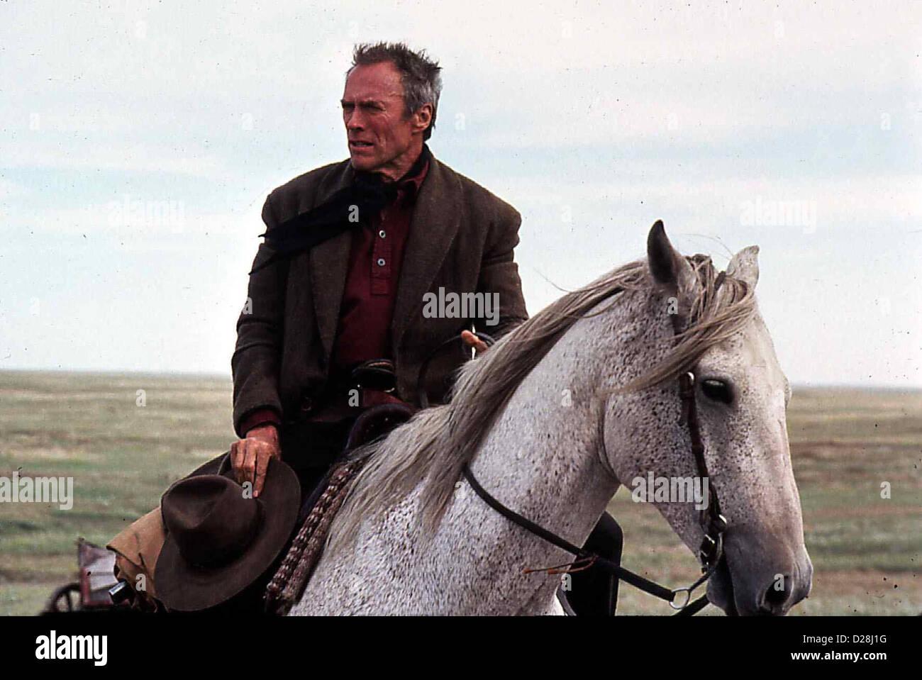 Erbarmungslos  Unforgiven  Clint Eastwood Bill Munny (Clint Eastwood), einst gefuerchteter Revolverheld, jetzt verarmter - Stock Image