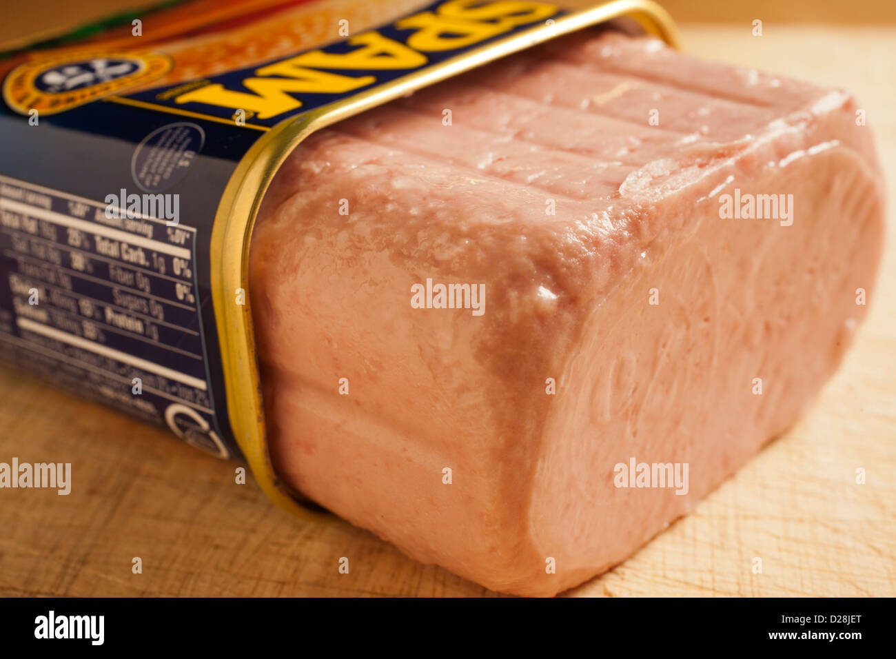 An open can of Spam showing the 75th anniversary imprint - Stock Image