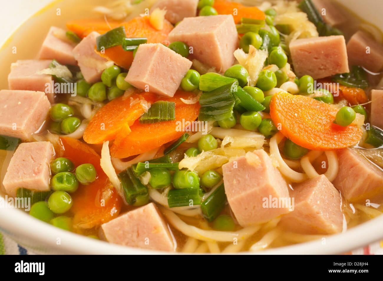Saimin with Spam Carrots and Peas, a Hawaiian classic - Stock Image