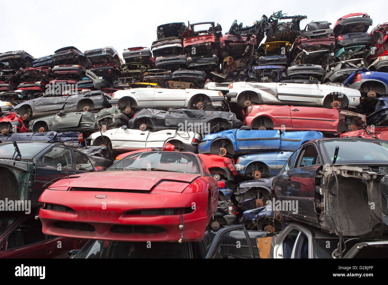 Trash Compactor Ruhr Germany Over Stacked Cars In A Junkyard Stock Photo