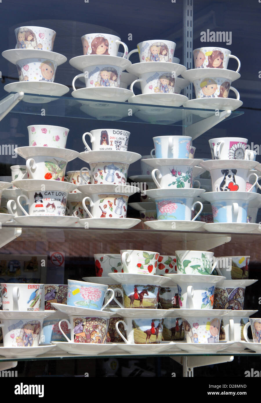 cups and saucers on display in shop window, Whitby, England, UK - Stock Image