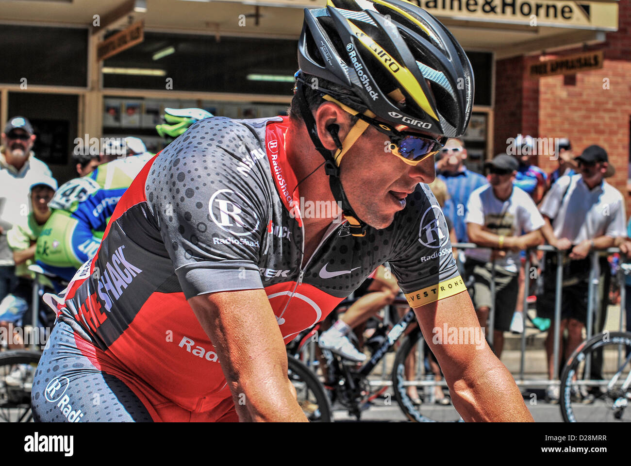 Lance Armstrong in his full cycling team uniform competing in Australia's Tour Down Under. - Stock Image