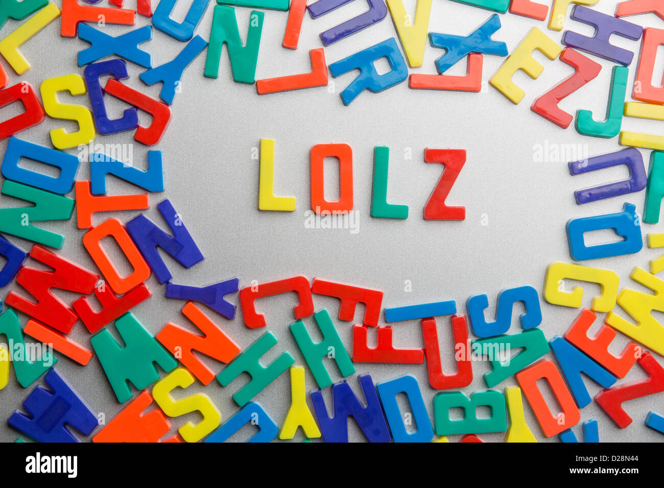 'LOLZ' - Refrigerator magnets spell messages out of a jumble of letters - Stock Image