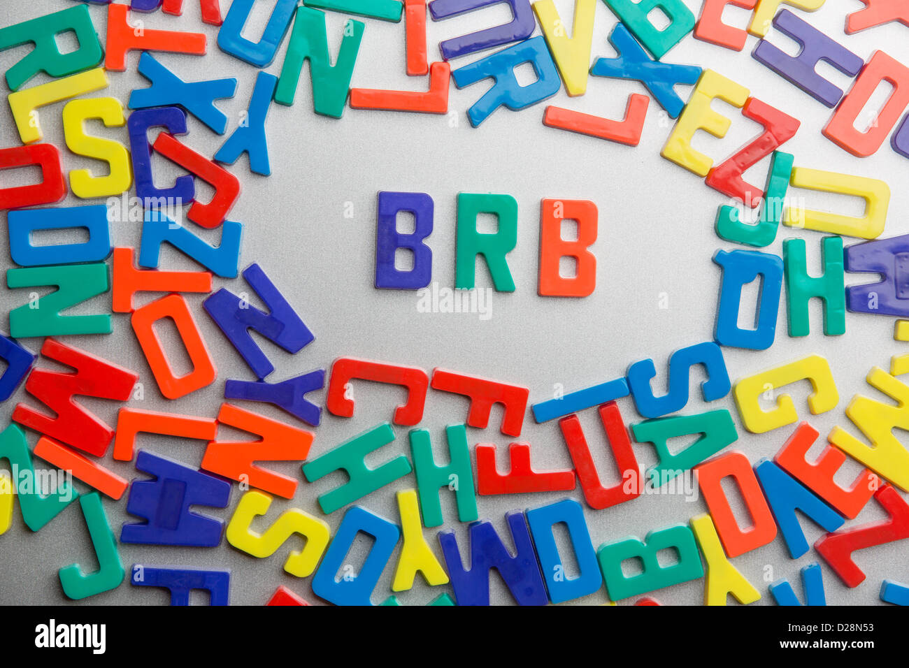 'BRB' -  be right back - Refrigerator magnets spell a message out of a jumble of letters - Stock Image