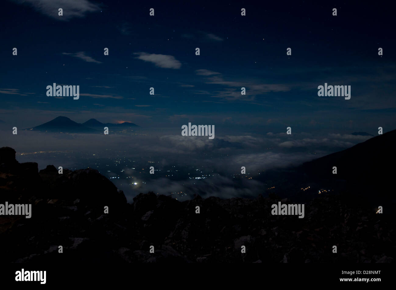 night view from the summit of Mount Merapi to the Merbabu volcano, Central Java, Indonesia - Stock Image