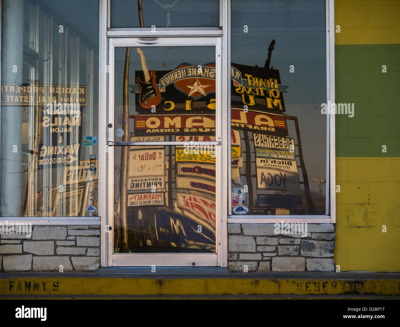 Reflections of the past - vintage Alamo Drafthouse sign in Austin, Texas reflected through the windows of empty - Stock Image