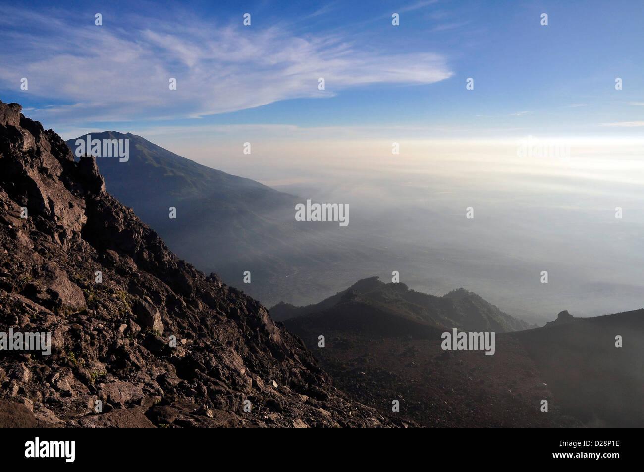 Mt. Merbabu volcano, Central Java, Indonesia from Merapi volcano - Stock Image