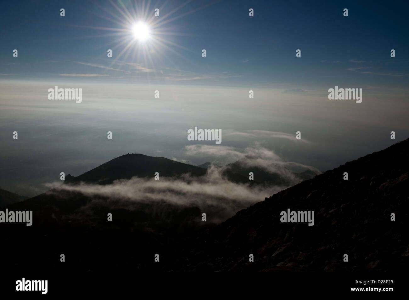 from the summit of Mt. Merapi, the cloudy sunrise, Central Java, Indonesia - Stock Image