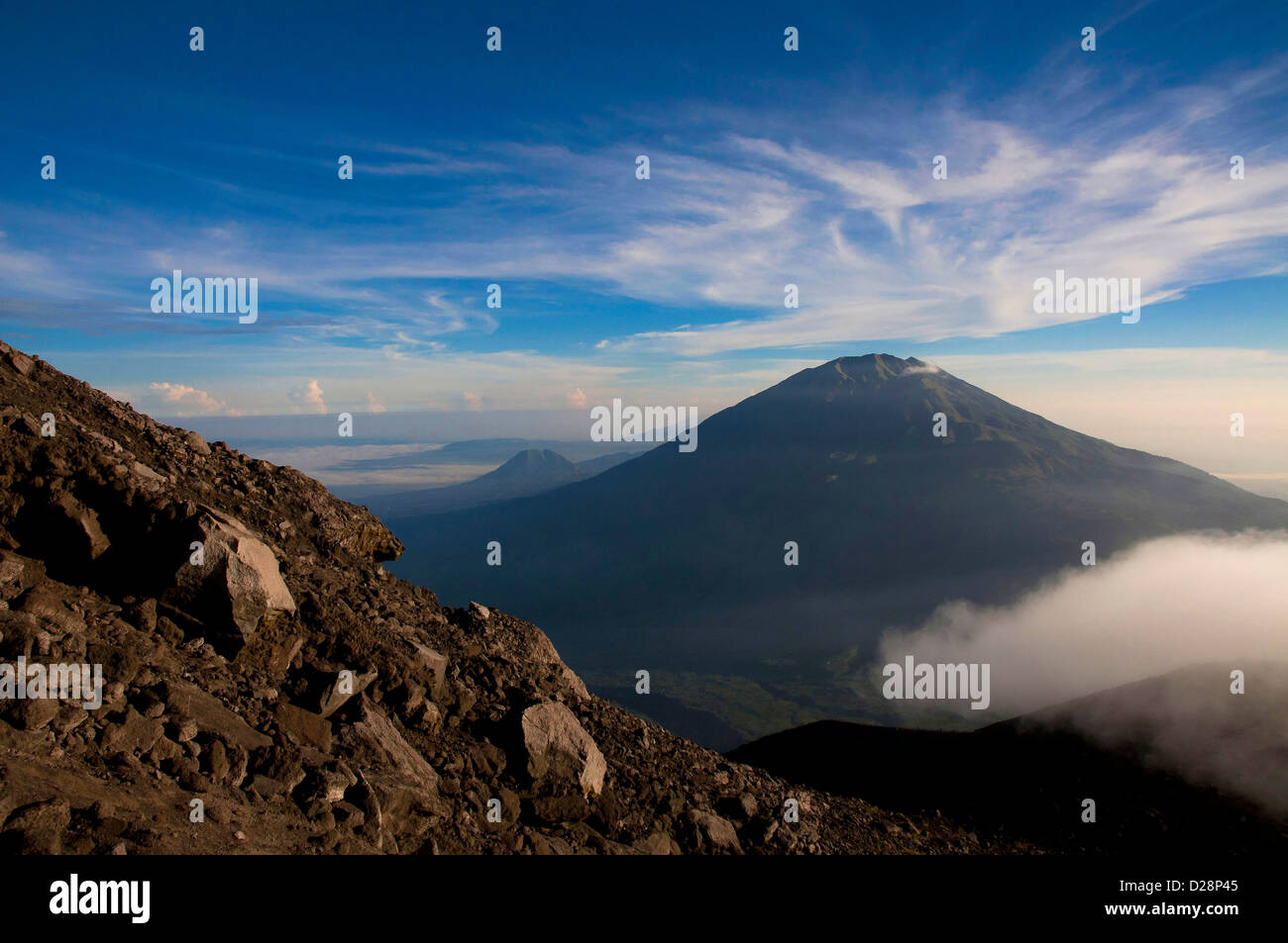 from the summit of mount Merapi the view of Mount Merbabu volcano, Central Java, Indonesia - Stock Image
