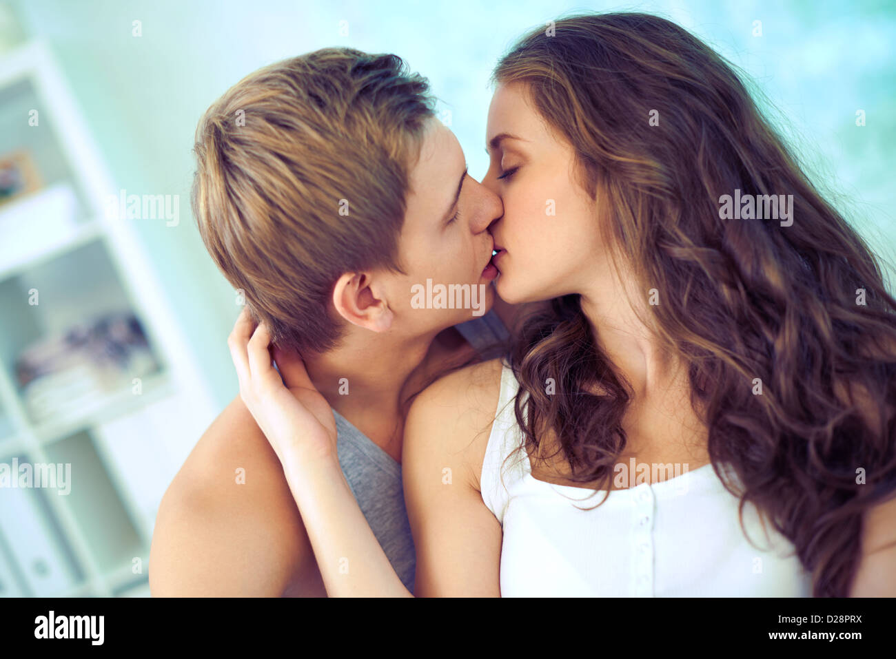 Young affectionate couple kissing tenderly - Stock Image