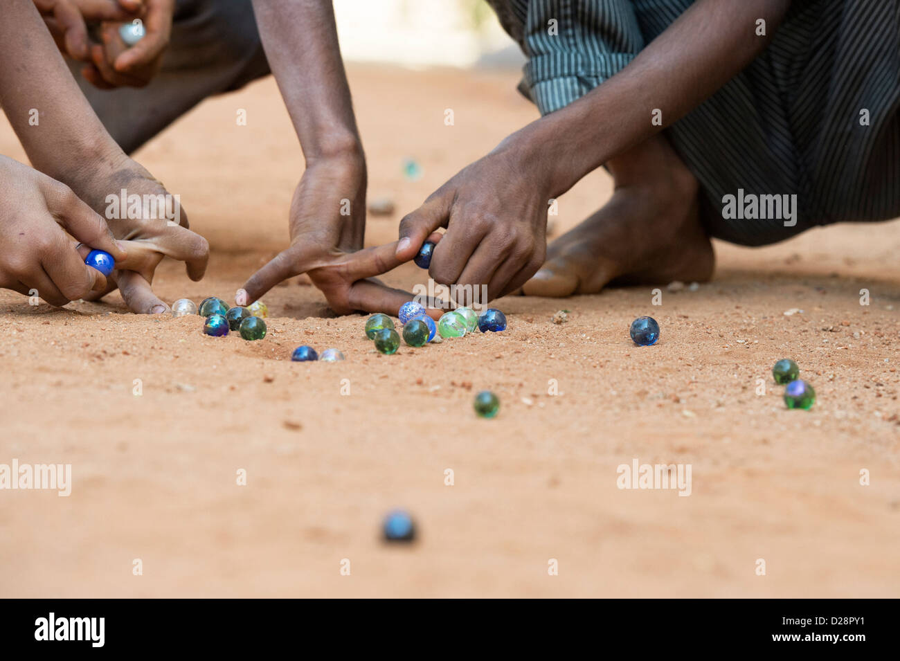 Indian boys playing marbles in a rural Indian village. Andhra Pradesh, India - Stock Image