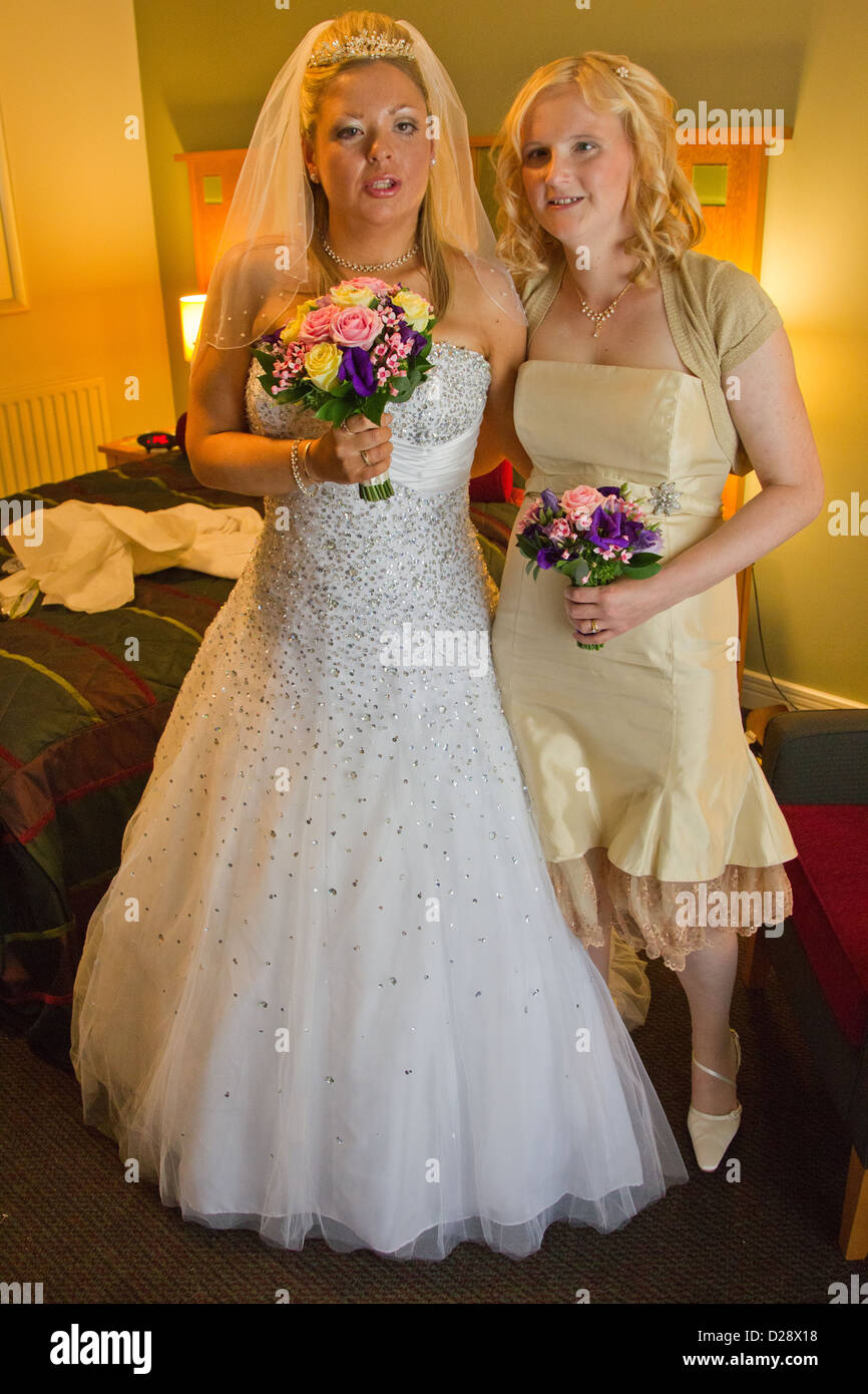 Visually impaired bride with her bridesmaid before the ceremony. - Stock Image