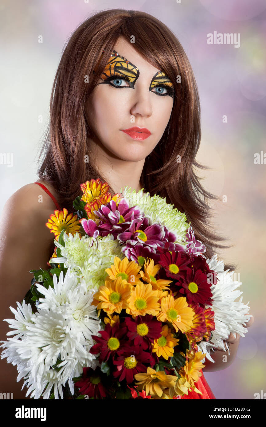 Beautiful woman with flowers and butterfly makeup stock photo beautiful woman with flowers and butterfly makeup izmirmasajfo