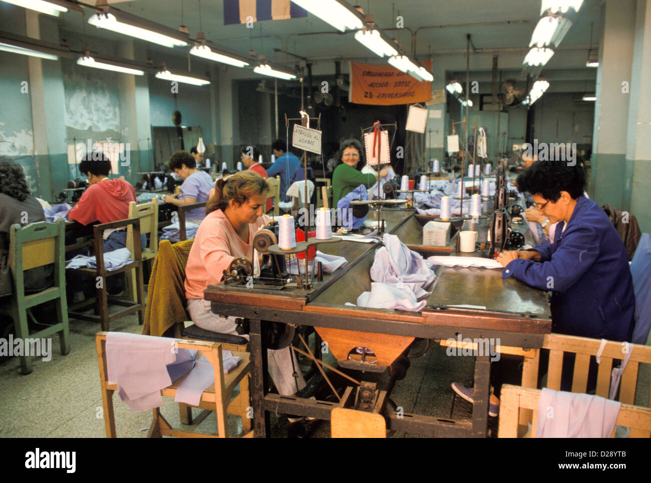 Cuba. Havana. Women Sewing Uniforms. - Stock Image