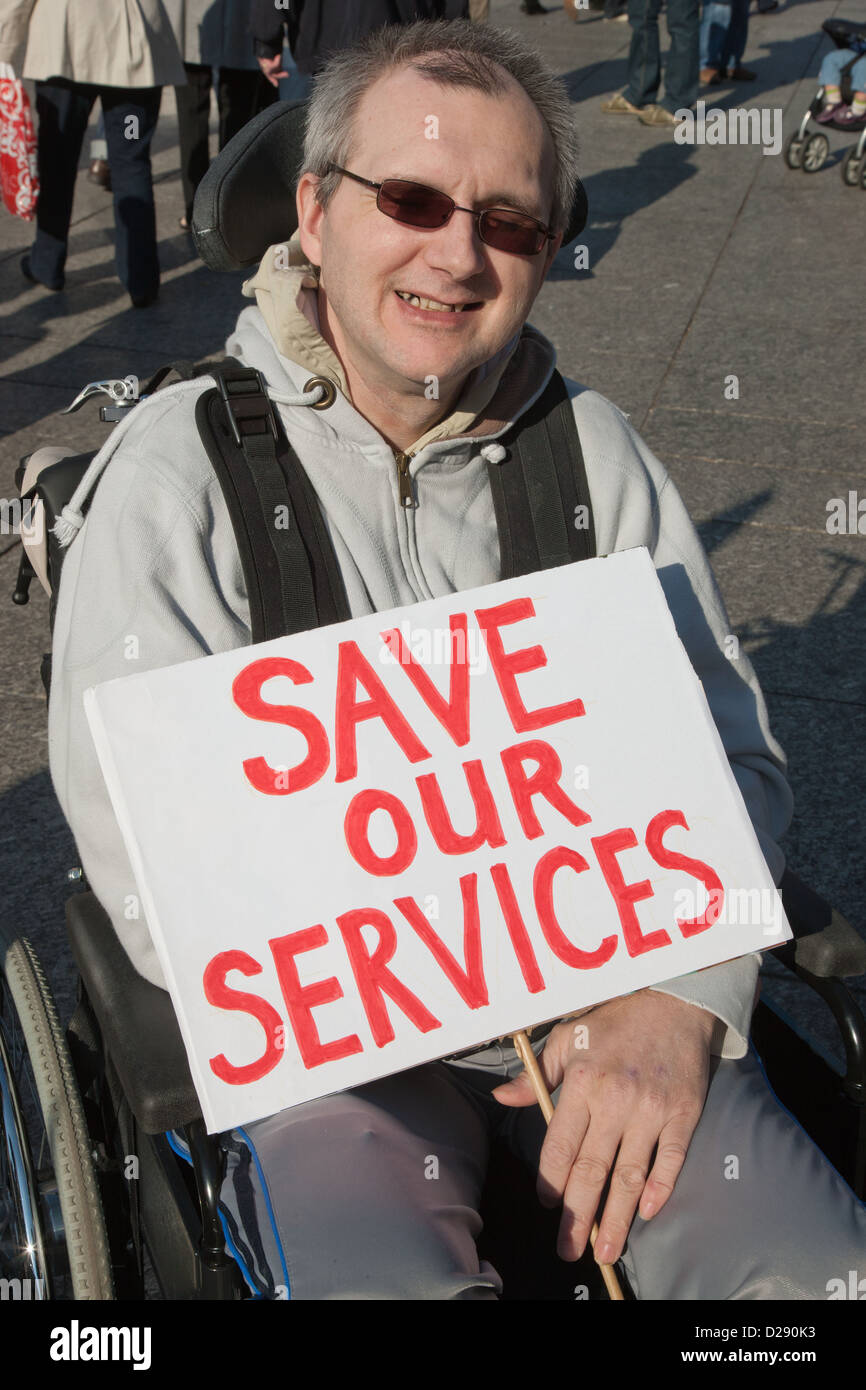 Demonstration against Coalition cuts to disabled people's services and income. Wheelchair user - Stock Image