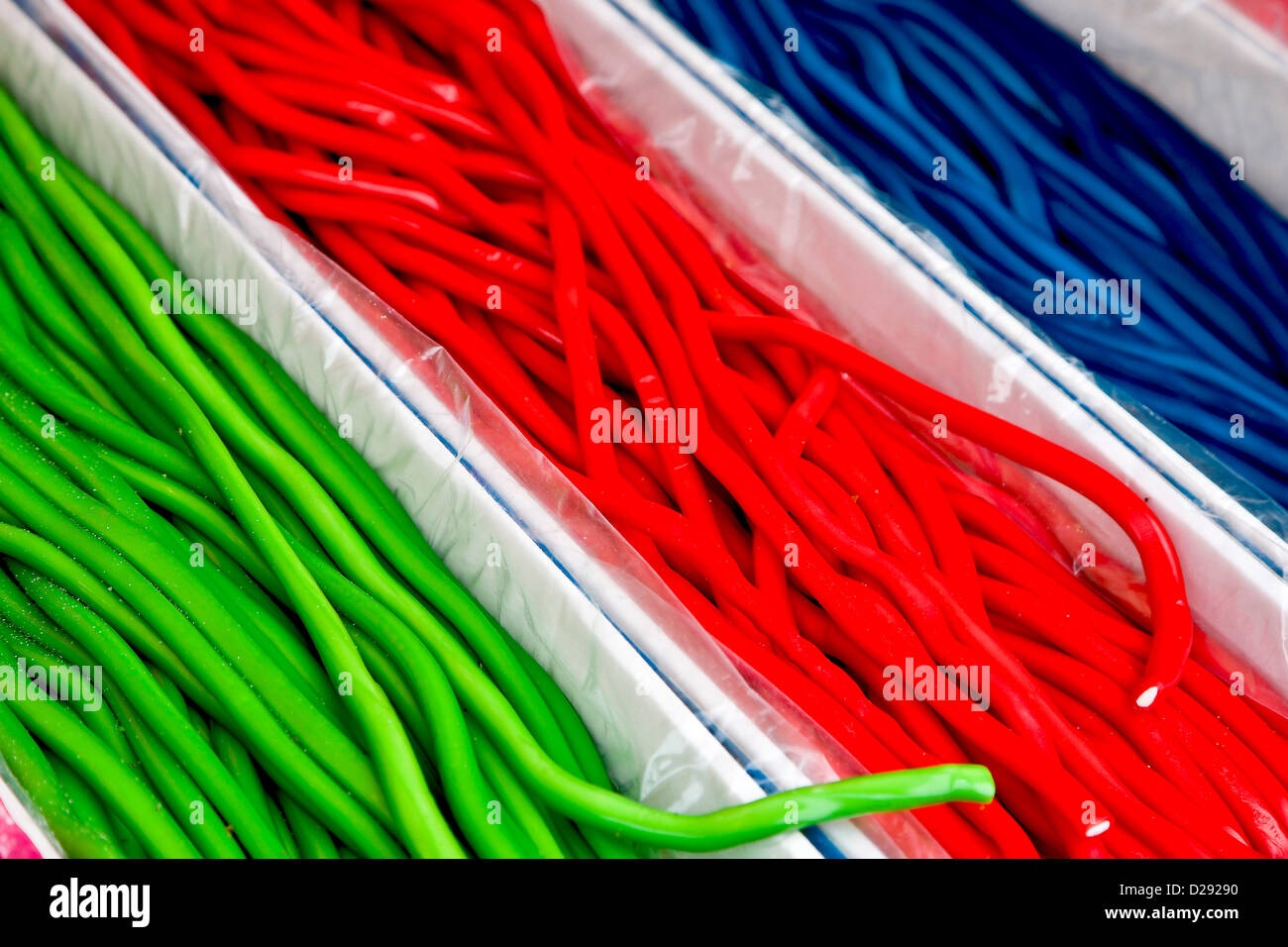 Colourful sweets in long lengths - Stock Image